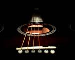 Obrázek - Tmavě zahalená kytara