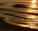 Obrázek - Vlny a paprsky zapadajícího slunce