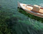 Obrázek - Mala loď ukotvená na vodě