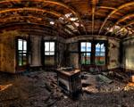 Obrázek - Zničená obývací místnost v domě