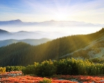 Obrázek na plochu - Východ slunce nad horami
