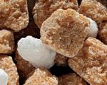 Obrázek - Kostky hnědého cukru v detailu