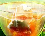 Obrázek - Pytlík s čajem ve sklenici s horkou vodou