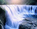 Obrázek - Říční vodopád za svitu raního slunce