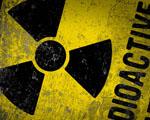 Obrázek - Radioaktivní znak na pozadí monitoru