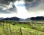 Obrázek - Pruh světla protínající mraky