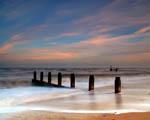 Obrázek - Západ slunce za lehce rozbouřeným oceánem