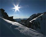 Obrázek - Zasněžené kopce hor v Tenibre