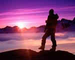Obrázek - Horolezec a horský západ slunce