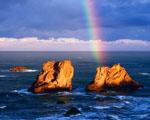 Obrázek - Skalní útesy osvětlené duhou