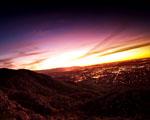 Obrázek - Západ slunce za městem