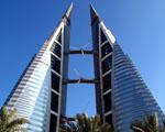 Obrázek - Budova s větrnou elektrárnou pro nižší splátky hypotéky