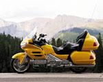 Obrázek - Žlutá silniční motorka